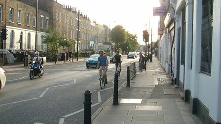 Cyclists on the 100-yard stretch of Balls Pond Road that connects the two segments of CS1. Picture: