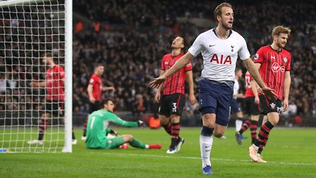 Tottenham Hotspur's Harry Kane (right) celebrates scoring his side's first goal of the game during t