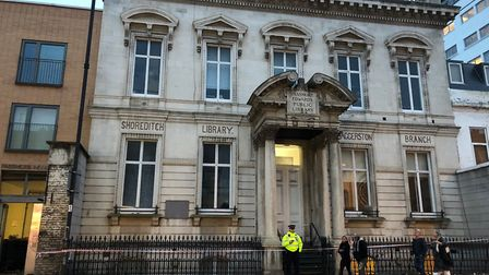 The Met's forensic team searched the former Shoreditch library in Kingsland Road following the stabb