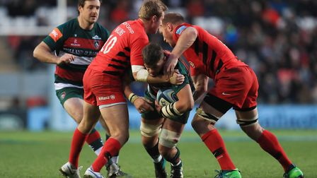 Leicester Tigers' Mike Williams is tackled by Saracens' Max Malins and Schalk Burger (pic Mike Egert