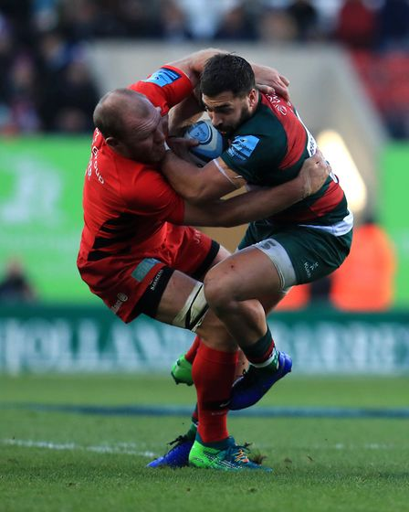 Leicester Tigers' Gareth Evans is tackled by Saracens' Schalk Burger (pic Mike Egerton/PA)