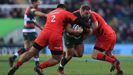 Leicester Tigers' Greg Bateman is tackled by Saracens' Christopher Tolofua and Christian Judge (pic