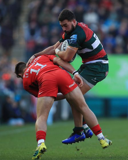 Leicester Tigers' Gareth Owen is tackled by Saracens' Alex Lewington (pic Mike Egerton/PA)