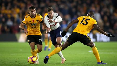 Wolverhampton Wanderers' Willy Boly (right) and Jonny Castro battle for the ball with Tottenham Hots