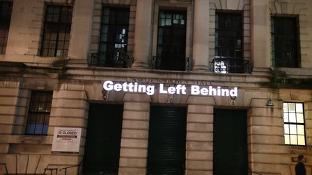 """""""Getting left behind."""" Divest Camden project their anti-fossil fuels message onto Camden Town Hall i"""
