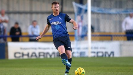 Marc Weatherstone knocks the ball forward for Wingate & Finchley (pic: Gavin Ellis/TGS Photo).