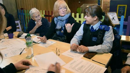 Members of the public debating strategies to tackle crime at the Sherriff Centre, West Hampstead. Pi