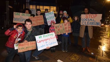 Hackney Green party members stand outside the Petchey Academy in the rain ahead of the Dalston Conve