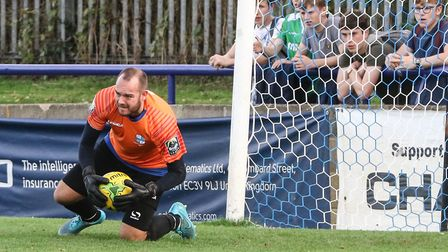 Wingate & Finchley goalkeeper Shane Gore claims the ball (pic: Martin Addison).