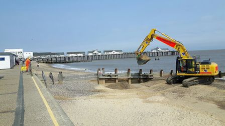 A large digger on Southwold beach helping to raise the level of the sand. Picture: Courtesy of Waven