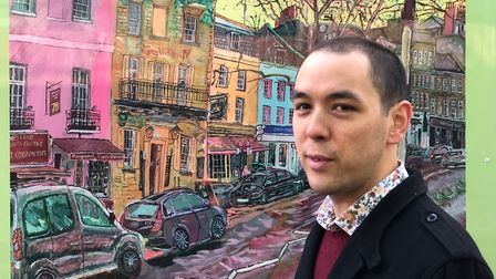Oliver Yu Chan with his painting of Hampstead High Street, which is on a hoarding outside the Royal