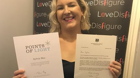 Sylvia Mac with her letter from the Prime Minister.