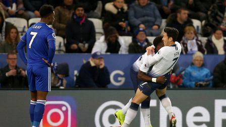 Tottenham Hotspur's Heung-min Son celebrates with Serge Aurier after scoring the opening goal during