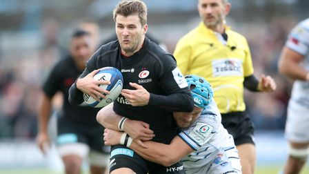 Saracens' Richard Wigglesworth (left) is tackled by Cardiff Blues' Olly Robinson during the Heineken