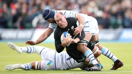 Saracens' Schalk Burger (centre) is tackled by Cardiff Blues' Olly Robinson during the Heineken Euro
