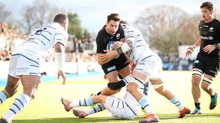 Saracens' Sean Maitland is tackled during the Heineken European Champions Cup, pool three match at A
