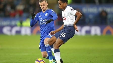 Leicester City's James Maddison (left) and Tottenham Hotspur's Kyle Walker-Peters battle for the bal