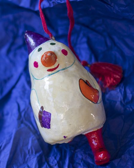 Georgina's beloved papier mache man was the first decoration selected with her children