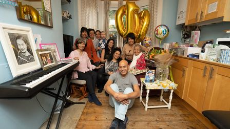 Mavis Jackson surrounded by her family on her 100th birthday. Picture: @siornaphotography