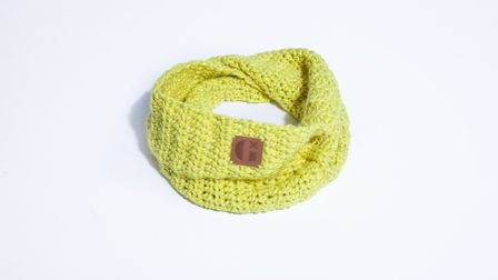 A Glow snood, made by women in the community