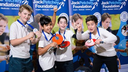 Pupils from Hackney's Sir Thomas Abney School celebrate their success at the East London final of th