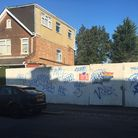 Hoardings outside the Annington Road premises in Fortis Green before graffiti was whitewashed. Pictu