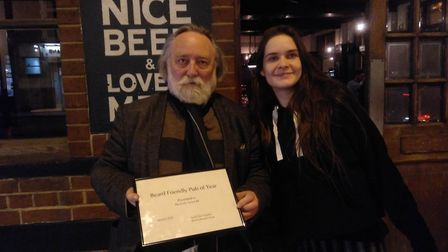 The Beard Liberation Front's Keith Flett awards Francesca from The Cock Tavern with the award.