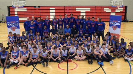The New York Knicks pose for a team portrait with children from the Jr. NBA League as part of the 20
