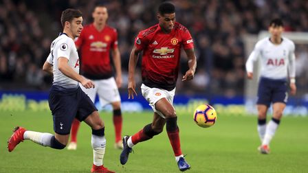 Manchester United's Marcus Rashford (centre) and Tottenham Hotspur's Harry Winks (left) battle for t