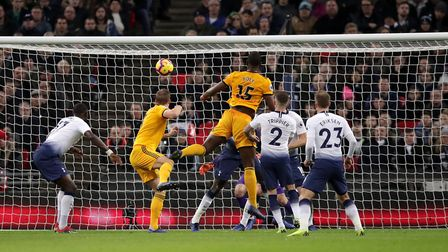 Wolverhampton Wanderers' Willy Boly scores his side's first goal during the Premier League match aga