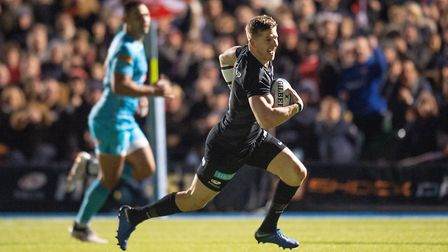 Saracens David Strettle charges through to score a try during the Gallagher Premiership match at All