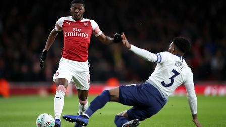 Arsenal's Ainsley Maitland-Niles (left) and Tottenham Hotspur's Danny Rose battle for the ball durin