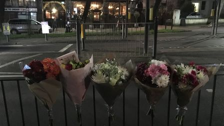 Floral tributes honour the woman who died after a collision in Hornsey High Street. Picture: Lucas C