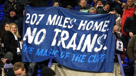 Tottenham Hotspur fans hold up a flag during the FA Cup third round match against Tranmere Rovers at