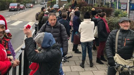 Swimmers waiting outside Park Road Leisure Centre on Christmas Day. Picture: Ruth Corney