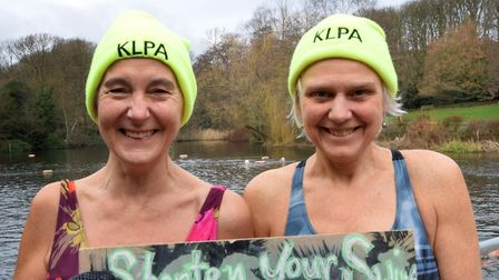 With the distinctive Kenwood Ladies's Pond Association hats pride of place, brave New Year's Day swi