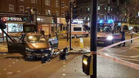 A police officer was injured after a car drove the wrong way down Stoke Newington High Street. Pictu