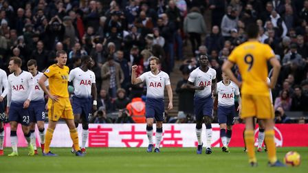 Tottenham Hotspur's Harry Kane (centre) celebrates scoring his side's first goal during the Premier