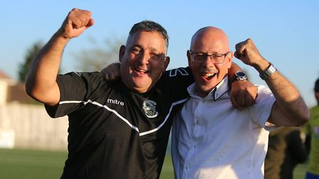 Haringey Borough manager Tom Loizou and chairman Aki Achillea celebrate at the final whistle after t