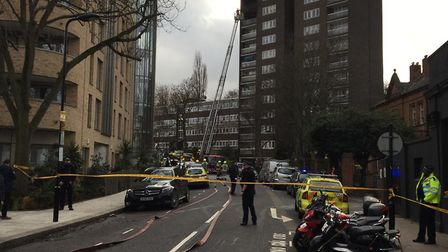 Police and the London Fire Brigade tackle the fire in Lawn Road. Picture: David Douglas