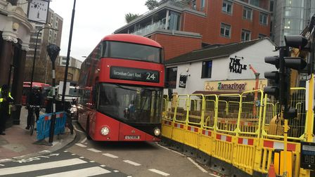A bus attempts to navigate the road closure at the junction of South End Green and Fleet Road. Pictu
