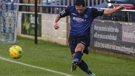Layne Eadie clears the ball forward for Wingate & Finchley (pic: Martin Addison).