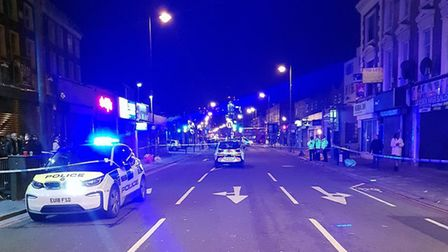 Police at the scene in Kingsland Road. Picture: @MPSHackney