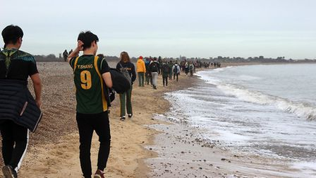 The walk took them along the shoreline into Southwold. PICTURE: T. O'Connell
