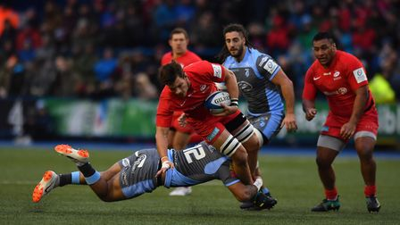 Mike Rhodes of Saracens is tackled by Cardiff Blues' Willis Halaholo in the Heineken Champions Cup (