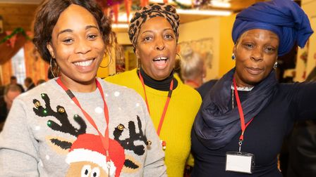Volunteers helping to serve Christmas dinner with a smile. Picture: Siorna Ashby