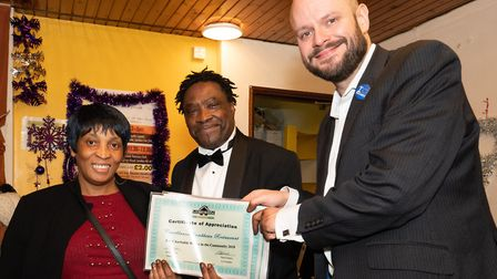 Juliene from Casablanca restaurant receives a certificate for weekly food donations with Errol Franc