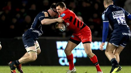 Saracens' Alex Goode is tackled by Sale Sharks' Tom Curry (pic: Richard Sellers/PA)