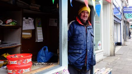 Paul Saxton with tins of celebrations at his newspaper stall in the Broadway. Picture: David Winskil