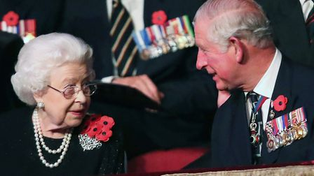 'Mollycoddled from birth' Queen Elizabeth II with the Prince of Wales during the British Legion Fest